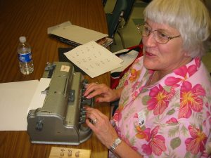 An IL student learning braille using the Perkins Braille Writer