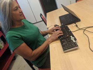 A SAAVI Student using only her keyboard and audio feedback from JAWS to use a computer